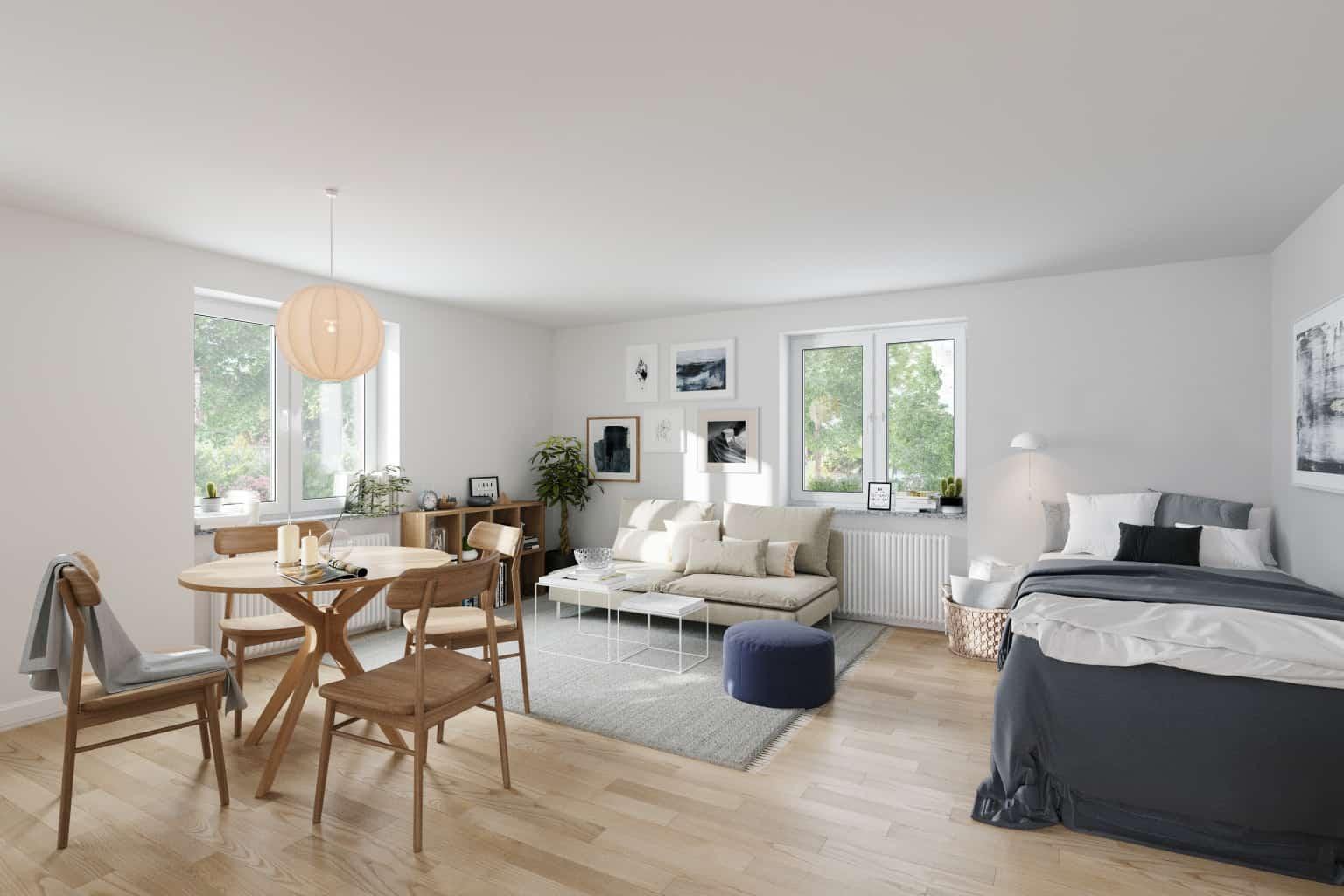 Interiörbild av en möblerad ett rum och kök.